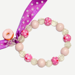 This bracelet features a pink ribbon and beads with polka dots, color changing pony beads and a unique donut charm.
